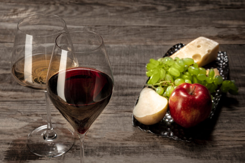 bottle-and-glasses-of-red-and-white-wine-with-fruits-1024x683